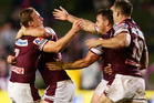 Daly Cherry-Evans of the Sea Eagles celebrates with team mates after kicking the winning field goal against the Knights. Photo / Getty Images