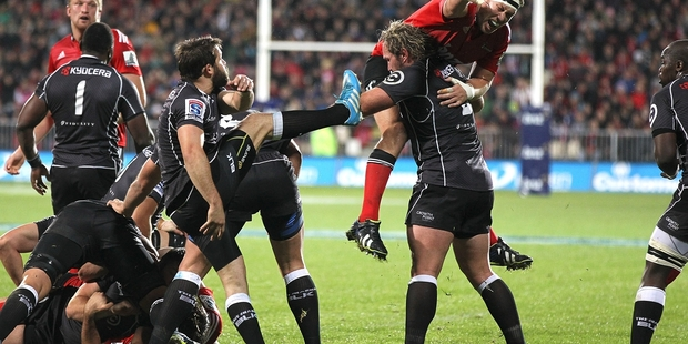 Cobus Reinach kicks as the Sharks pull off one of the most stunning victories of the season. Photo / Getty Images