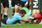 Bernard Foley scores the opening try in the Waratahs's win over the Lions. Photo / Getty Images