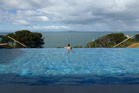 The house's infinity pool, with a view out to Rangitoto Island. Photo / Justine Tyerman