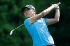 Lydia Ko watches her tee shot on the fifth hole during the final round of the Kingsmill Championship. Photo / AP