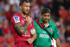 Quade Cooper of the Reds leaves the field against the Rebels. Photo / Getty Images