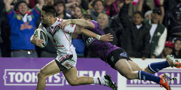 Shaun Johnson is denied a last minute try by the tackle of Josh Morris. Photo / Brett Phibbs