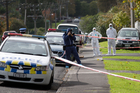 Police at a scene on Salisbury Rd in the Auckland suburb of Birkdale where personal belongings of missing women Blesilda Gotingco where found near her family home. Photo / Richard Robinson
