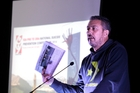 Mike King addresses the National Suicide Prevention Conference in Wanganui, making his point with a copy of Thursday's Chronicle and its coverage of the conference.  Photo/Bevan Conley