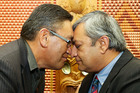 Mana leader Hone Harawira (left) and Internet Party chief executive Vikram Kumar perform a hongi after signing an alliance agreement. Photo / Getty Images