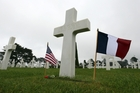 US and French flags fly at a cemetery in Colleville-sur- Mer, Normandy where thousands of American soldiers are buried. Photo / AP