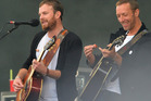 Kings of Leon's Caleb Followill performs with Chris Martin during Radio 1's Big Weekend in Glasgow. Photo/AP