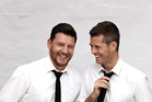My Kitchen Rules hosts Manu Feildel and Pete Evans.