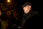 Kim Dotcom speaking to the media after a candlelight vigil at the home of Prime Minister John Key in Parnell. Photo / Sarah Ivey