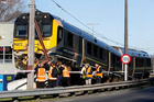 The Metlink Matangi train is inspecting by Transrail staff after crashing over a barrier at the Melling Station in Lower Hutt. Photo / Mark Mitchell