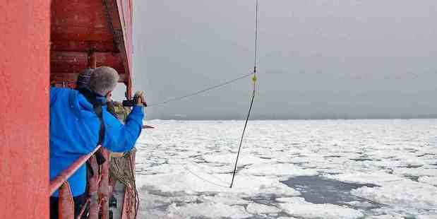 A buoy to measure waves is lowered on to sea ice. Photo / Rob Johnson