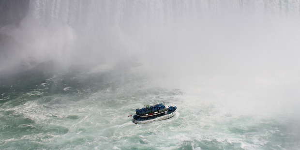 The 16-storey-high falls make an awesome sight from the boats. Photo / Bloomberg