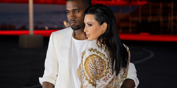 Singer Kanye West, left, and television personality Kim Kardashian IN 2012.