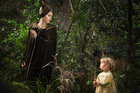 Angelina Jolie as Maleficent, with the young Aurora, played by her daughter Vivienne Jolie-Pitt.