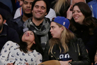Michelle Rodriguez is an electronic cigarette fan, blowing rings in front of Cara Delevingne. Photo / AP