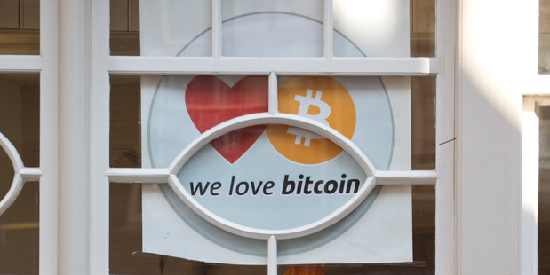 "A tea house which carries a sign reading ""We Love Bitcoin"", in Amsterdam. Dutch banks are embracing bitcoin ventures as potential customers. Photo / AP"