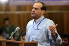 Mahafarid Amir Khosravi speaks at his trial in a court in Tehran, Iran. Khosravi. Photo / AP