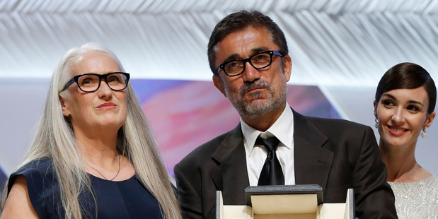 Loading Cannes Jury President Jane Campion, left, with director Nuri Bilge Ceylan after he won the Palme d'Or award for his film Winter Sleep (AP).