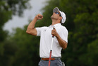Adam Scott celebrates after sinking the winning putt on the 18th hole during the third playoff in the final round of the PGA Colonial golf tournament in Fort Worth, Texas. Photo / AP
