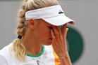 Denmark's Caroline Wozniacki wipes her face during the first round match of the French Open tennis tournament. Photo / AP