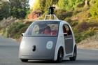 Members of the public try a protoype of Google's self-driving two-seater car, which will have no controls other than a stop-go button. Photo / AP