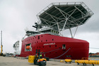 Australian vessel Ocean Shield docks while being fitted with an autonomous underwater vehicle used in the search. Photo / AP