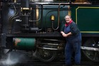 Shantytown steam train driver Iona Littlejohn shows off the engine at the start of a day's travel in the South Island.  Photo / Stephen Parker