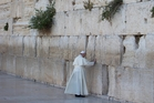 Pope Francis prays in front of the Western Wall in Jerusalem's Old City yesterday as part of his Middle East pilgrimage. Photo / AP