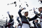 President Obama told West Point cadets, seen celebrating graduation, that the challenge would be in how the US secured world peace and prosperity. Photo / AP