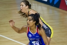 Temalisi Fakahokatau of the Mystics, front, makes life difficult for Irene Van Dyke of the Pulse. Photo / Sarah Ivey