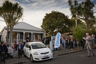 Crowds gather outside the Ponsonby villa as auctioneer Mark Sumich gets under way. Photo / Greg Bowker
