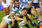 Sam Burgess of the Rabbitohs scores a try against the Sharks. Photo / Getty Images