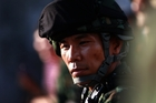A soldier confronts protesters in Bangkok. Photo / AP