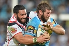 Konrad Hurrell tackles Dave Taylor of the Titans on Saturday night. Photo / Getty Images