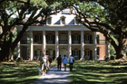 Visitors to the Oak Alley Plantation walk through the dappled shade of the avenue to the main house at Vacherie, in Louisiana. Photo / Paul Rush