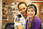 Child Cancer Foundation ambassador Quinn Hautapu meets actress Frankie Adams behind the scenes of Shortland St. Photo / Matt Klitscher / South Pacific Pictures
