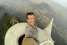 Lee Thompson takes the selfie from the top of Christ the Redeemer statue in Rio de Janeiro. Photo / Snapper Media