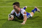 Five-eighth Chad Townsend, above, and star halfback Shaun Johnson have been combining to exert their influence on a winning Warriors side. Photo / Brett Phibb