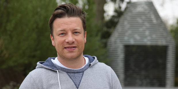 Celebrity chef Jamie Oliver reckons women are better at handling the heat of a barbie. Photo / Getty