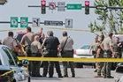 Officers outside the Georgia courthouse where heavily armed gunman Dennis Marx was shot dead. Photo / AP
