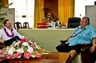 John Key and Samoan Prime Minister Tuilaepa Sailele Malielegaoi catch up in Apia.