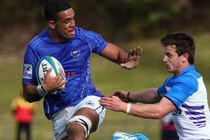Giovanni Habel Kueffner of Samoa fends off the tackle of Alex Glashan of Scotland. Photo / Getty Images