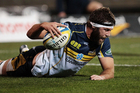 Leon Power of the Brumbies stretches out for a try. Photo / Getty Images.