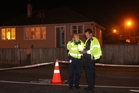 Police at the scene of the drive-by shooting in Waipukurau. Photo/Duncan Brown