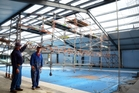BIG JOB:  Les Feasy and Bill Wigglesworth work on the Kawakawa pool's roof. PHOTO / DEBBIE BEADLE