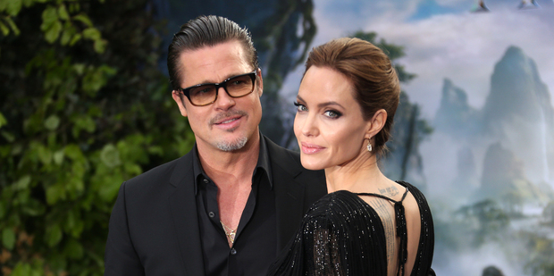 Brad Pitt and Angelina Jolie at the Malificent premiere at which Pitt was accosted by a celebrity prankster. Photo/AP