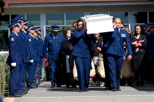 The coffin of Constable Kali Fungavaka is carried out of the LDS Stake Centre in Otara during his funeral. Photo / Dean Purcell
