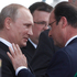 French President Francois Hollande right, speaks with Russian President Vladimir Putin during the D-Day commemoration at the Ouistreham beach, France. Photo / AP