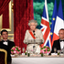 Britain's Queen Elizabeth II, centre, delivers a speech as French President Francois Hollande, right, looks on at the start of a state dinner at the Elysee presidential palace in Paris. Photo / AP